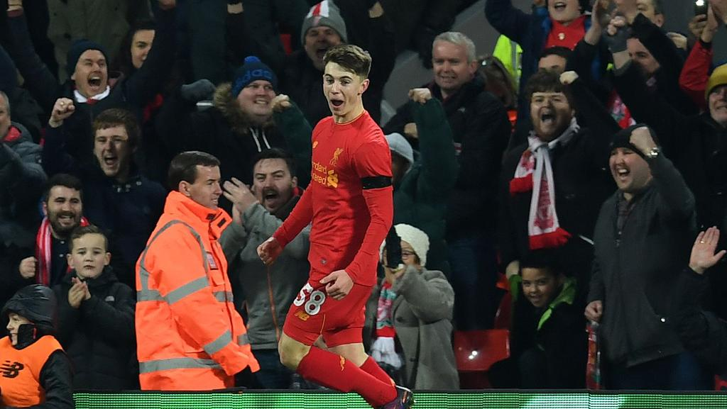 Liverpool's Welsh striker Ben Woodburn (L) celebrates scoring his team's second goal against Leeds.