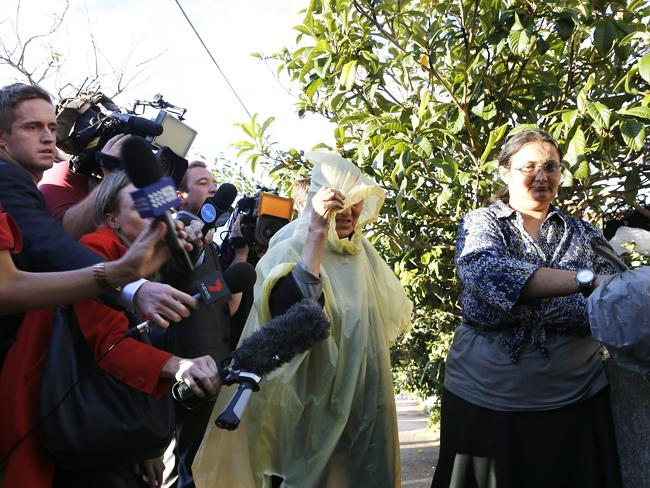 Mary and Elena Bobolas are approached by the media. Picture: Bradley Hunter