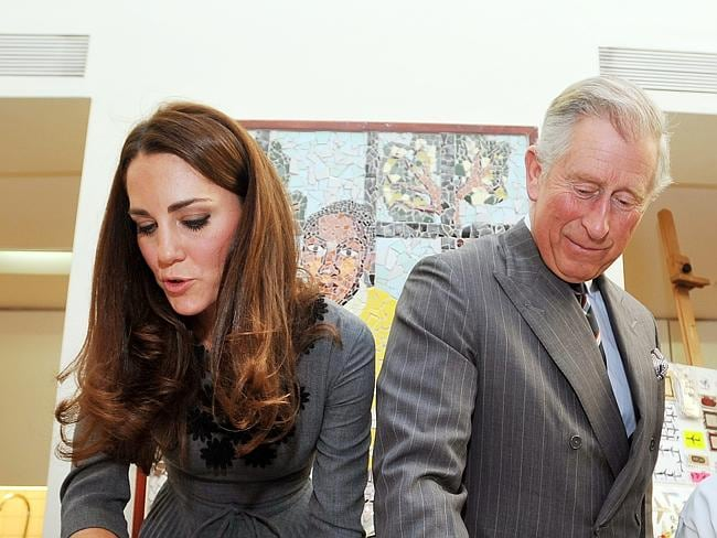 Prince Charles, The Prince of Wales and Kate, Duchess of Cambridge iron artwork they had just made onto silk, during a visit to the Dulwich Picture Gallery in south London. It was the first time Kate had joined Charles on a visit to one of his charities. Picture: AP
