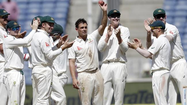 Australia's Steve O'Keefe, center, celebrates his fifth wicket in the second innings of the first test cricket match against India in Pune, India, Saturday, Feb. 25, 2017. (AP Photo/Rajanish Kakade)