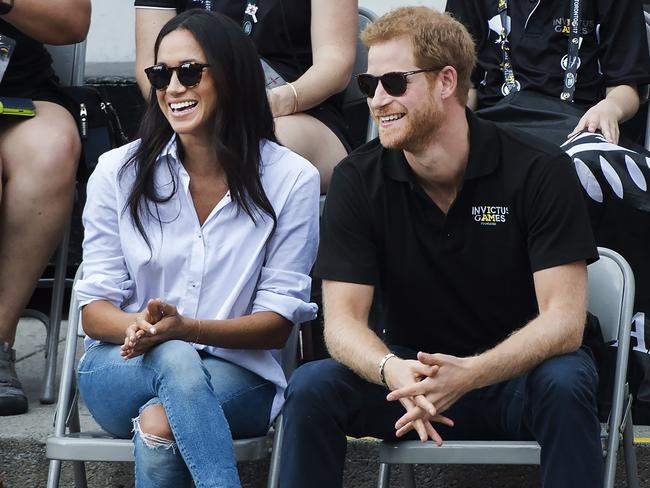 Prince Harry and his girlfriend Meghan Markle were all smiles. Picture: Nathan Denette/The Canadian Press via AP