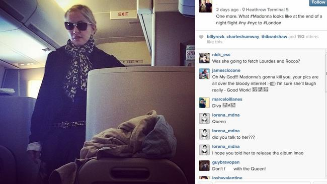 Sunglasses on a plane - total rock star move, Madge.