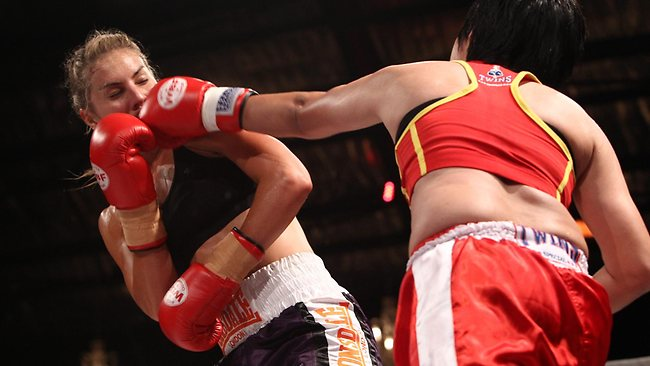 Lauren Eagle takes a hit from Kiangsak Sithsaithong before recording a fifth-round stoppage win. Picture: Ben Swinnerton