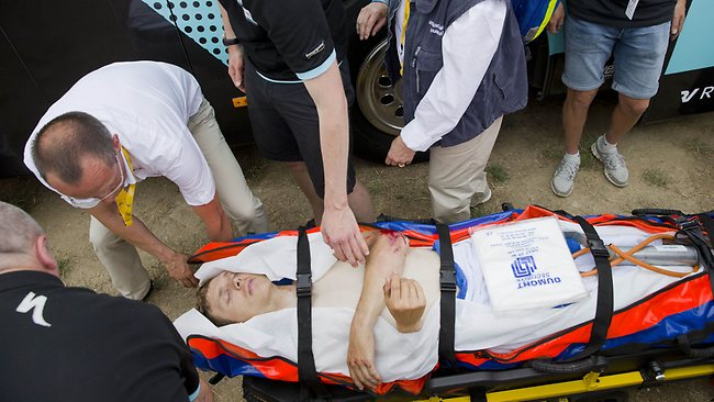 Germany's Tony Martin is taken to an ambulance at the finish line after crashing in the first stage of the Tour de France. AFP PHOTO / DANIEL SANNUM LAUTEN