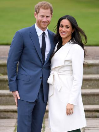Meghan Markle wore a white coat at the photocall for her engagement to Prince Harry. Picture: Karwai Tang/WireImage