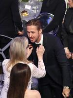Meryl Streep helps Ryan Gosling during The 23rd Annual Screen Actors Guild Awards at The Shrine Auditorium on January 29, 2017 in Los Angeles, California. Picture: Getty