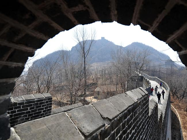 People make their way toward the summit watchtower on Tiger Mountain Great Wall. Picture: Supplied