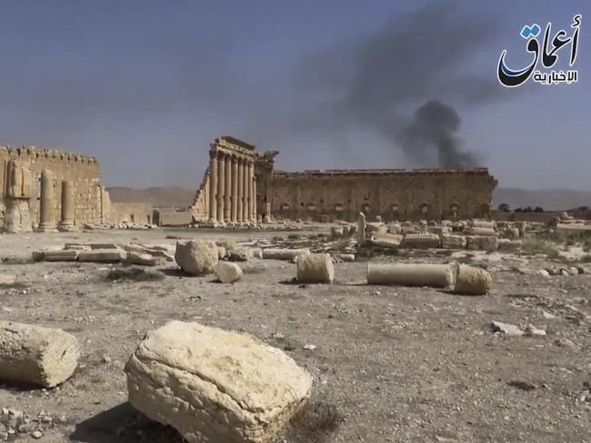 Delicate remains ... Smoke rises behind archaeological ruins in Palmyra, Syria. The video released by a media arm of the Islamic State group purportedly showed the archaeological ruins of Palmyra apparently undamaged. Source: AP