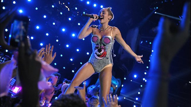 This image released by MTV shows Miley Cyrus performing at the MTV Video Music Awards at Barclays Center on Sunday, Aug. 25, 2013, in the Brooklyn borough of New York. (AP Photo/MTV, John Shearer)