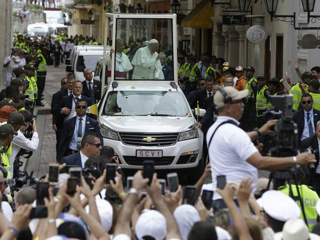 People greets Pope Francis as he arrives in his popemobile at the San Pedro Claver church Cartagena, Colombia. Picture: Ricardo Mazalan/AP