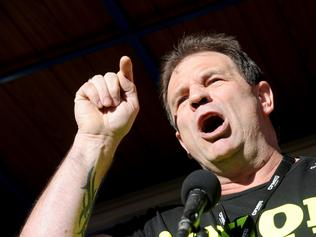 CFMEU secretary John Setka speaks as building and construction workers march during a rally in Melbourne, Tuesday, June 20, 2017. The CFMEU is rallying against the federal government's reintroduction of the Australian Building and Construction Commission, changes to the Building Code, possible cuts to penalty rates and attacks on workers' rights. (AAP Image/Joe Castro) NO ARCHIVING