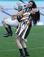 <p>NRL Grand Final rehearsal at Telstra Stadium . The Veronica sisters - Lisa (West Tigers top) and Jess ( in the North Queensland colours</p>