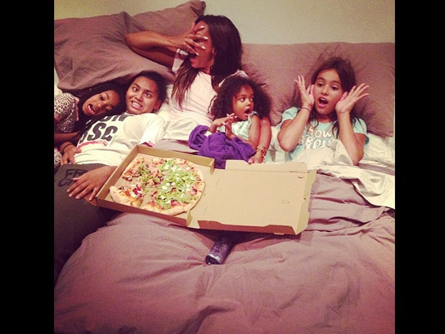 "British singer Mel B with her daughters, ""No vampires here no no no!!! Nothing like family movie time with my girls, ya just can't beat it, right?"" Picture: Instagram"