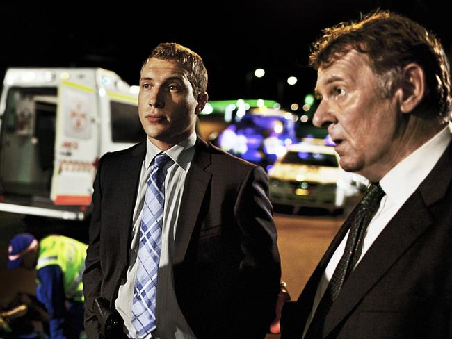 Suited up ... Jai Courtney (left) and Tom Wilkinson in a scene from Felony.