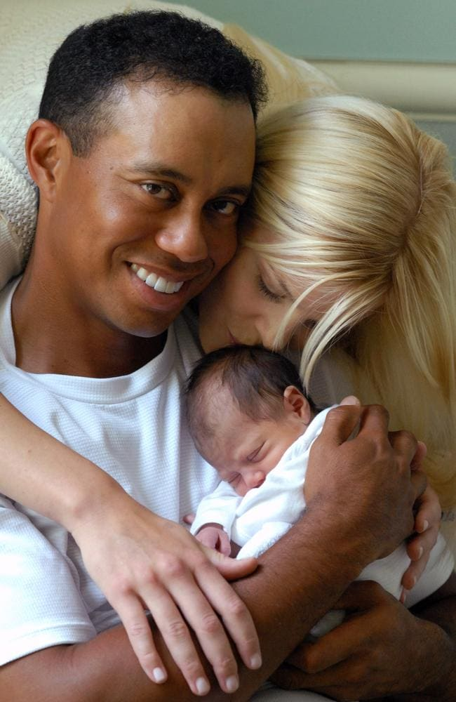 Double life ... golfer Tiger Woods, pictured with then-wife Elin and their newborn daughter Sam Alexis, shocked the world when he announced he was a sex addict. Picture: Gretchen/Dow/Mashkuri.