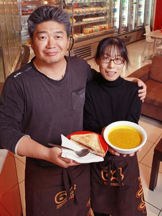 Michelle and James Kim, owners of cafe Latte n Lunch on Waymouth Streret, with a bowl of pumpkin soup ... one of our top five spots in the city to get a hearty filler.