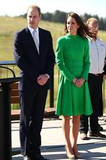 <p>Weasring a green Catherine Walker dress Catherine, Duchess of Cambridge stands with husband Prince William, Duke of Cambridge on a visit the National Arboretum in Canberra, Australia. Picture: Getty</p>