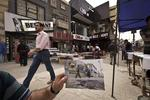 <p>In this Saturday, March 16, 2013 photo, shoppers walk in Baghdad's busy shopping district of Karrada, at the same site of an Associated Press photo taken by Hadi Mizban on Monday, Sept. 29, 2008 after a bombing that killed 22 people.</p>  <p>Bloody attacks launched by terrorists who thrived in the post-invasion chaos are painfully still frequent, albeit less so than a few years back, and sectarian and ethnic rivalries are again tearing at the fabric of national unity. Picture: AP</p>