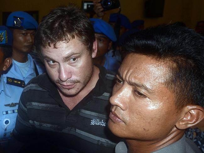 Heavily guarded ... Matt Lockley is taken into the airport after being arrested on arrival at Ngurah Rai airport.