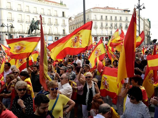 People hold Spanish flags during a demonstration against a referendum on independence for Catalonia in Madrid. Picture: AFP