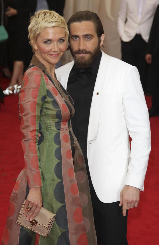 Surely a man bun would have been safer, Jake? He's with sister Maggie at the 'Charles James: Beyond Fashion' Costume Institute Gala on May 5, 2014.