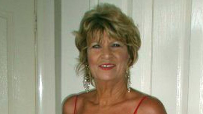 Michelle Smith, 60, was stabbed in the heart after two men on a motorbike attempted to snatch her bag.
