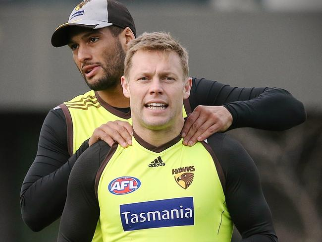 Josh Gibson gives Sam Mitchell an impromptu massage at training. Picture: Wayne Ludbey