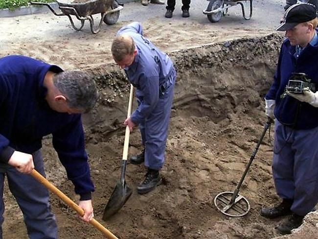Grisly search ... Irish police dig for the body of Jean McConville in a car park at Templetown Beach in Dundalk in 1999. Her body was eventually found in 2003. Picture: AP
