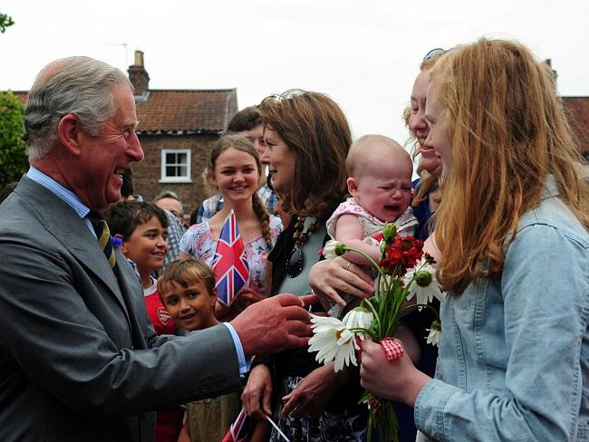 Britain's Prince Charles, the Prince of Wales, with 6 month old Emily Scott, as he meets crowds of well wishers on a visit to Bugthorpe, England this year. Picture: AP