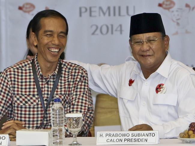 Head to head ... presidential candidates Joko Widodo and Prabowo Subianto share a light moment prior to drawing the electoral ballot. Picture: Tatan Syuflana