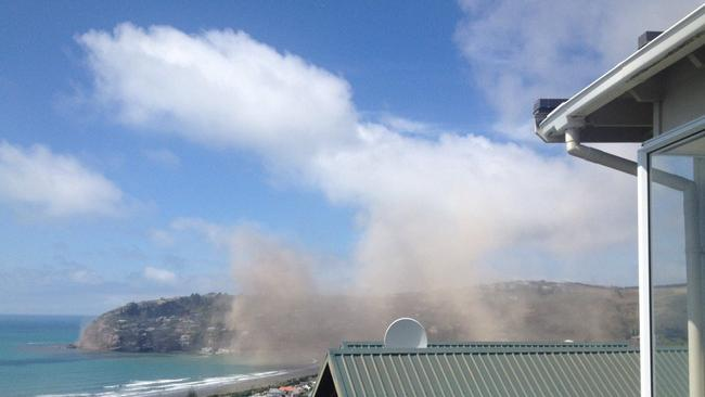 Dust is seen falling from the cliffs of Sumner near Christchurch. Picture: Rob Simcic/Twitter