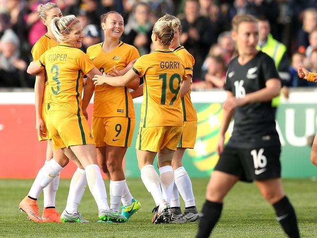 Caitlin Foord celebrates a goal with team mates during the women's international friendly match between Australia and New Zealand last year.