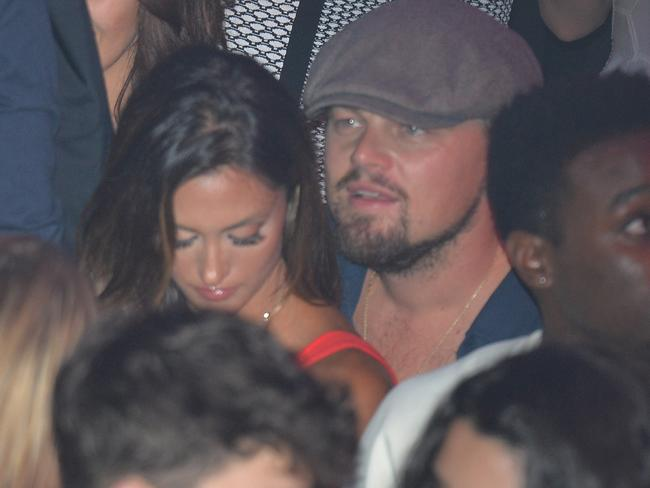 DiCaprio and Katie Cleary partying at the Gotha club in Cannes on May 19, 2014.