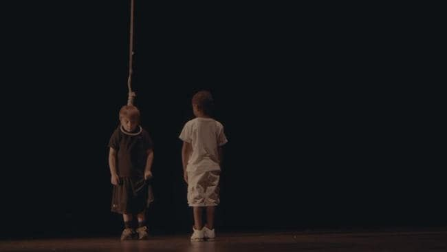 The video sees the boy hoisted above the stage by the rapper. Source: YouTube