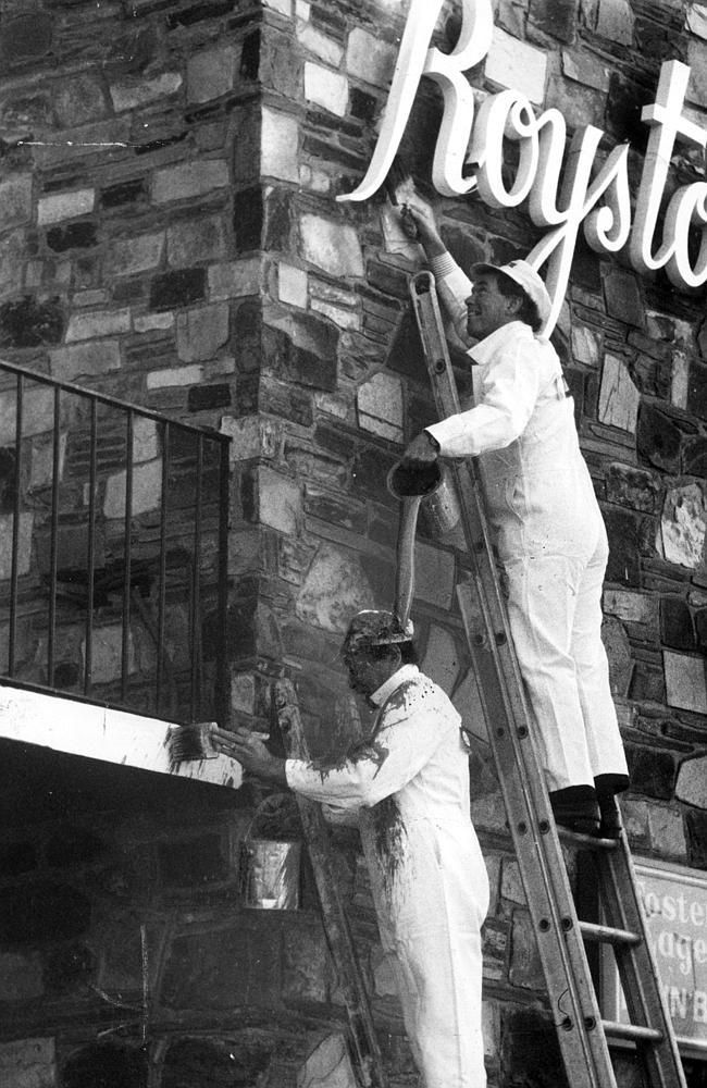 Adrian 'Gags' Gallagher' and Ron Barassi paint the Royston Hotel in Richmond.