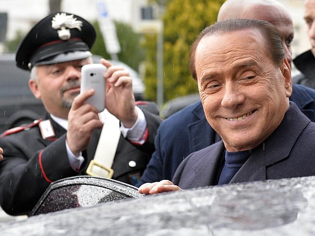 Gone to the dogs ... Berlusconi's Forza Italia party was hit hard by his political downfall last year.