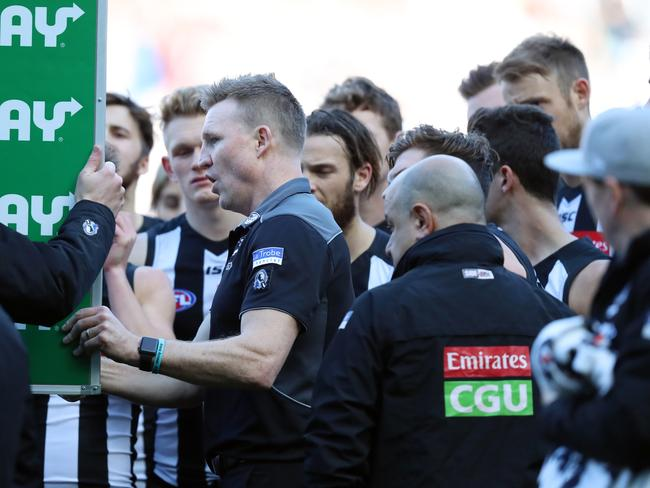 Collingwood Coach Nathan Buckley talks to the team at quarter time. Picture: Alex Coppel.