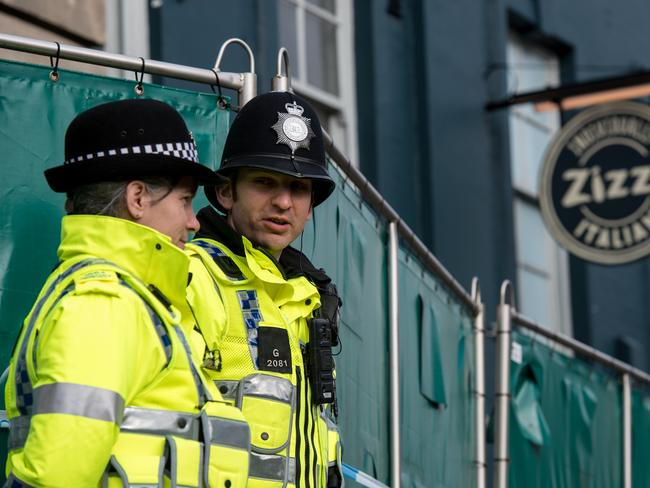 Police officers stand outside Zizzi restaurant as it remains closed as investigations continue into the poisoning. Picture: Getty