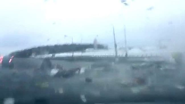 The car ploughs through a rain of debris as the plane carshes just metres away.