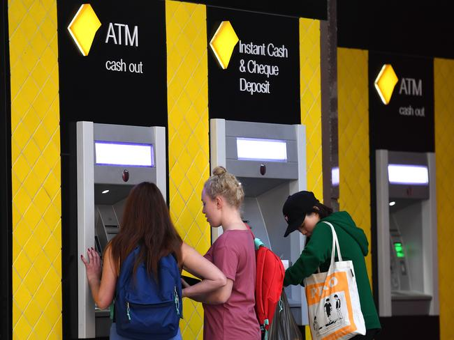 Customers use a Commonwealth Bank (CBA) intelligent ATM. Picture: AAP