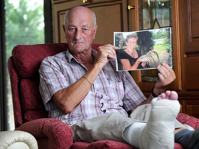 Wynand Krottje holds a photo of his wife Viviane, who was struck and killed by a car outside the Day On the Green concert. Picture: Tricia Watkinson.