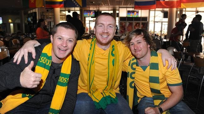 Fans Dan Cairns, Adrian Stanton, Nathan Dundovic in their Socceroos attire.