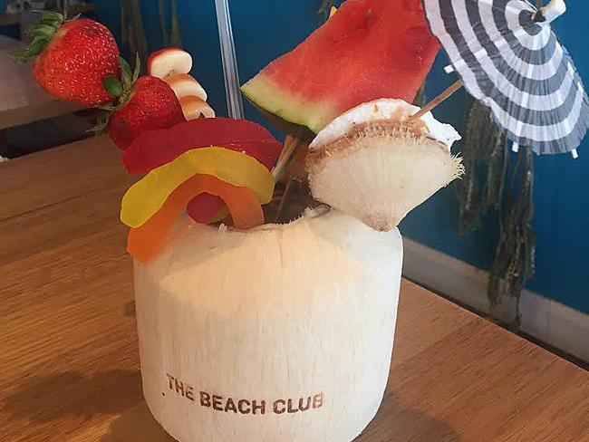 The signature cocktail, with fruit and lollies, at the Beach Club at the Cottesloe Beach Hotel.