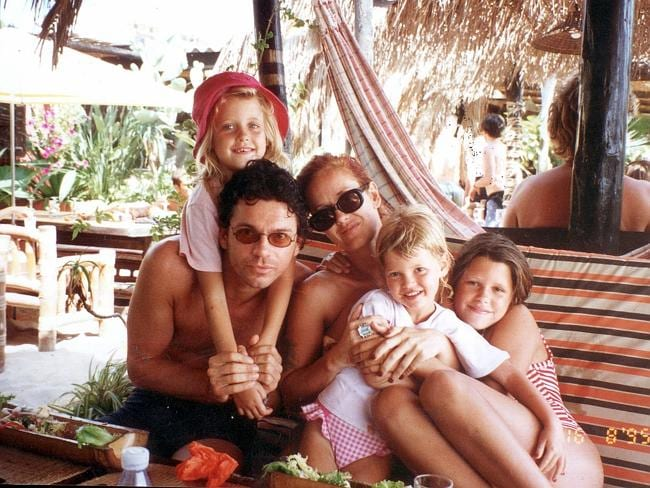 A different life... Michael Hutchence and Paula Yates with her daughters Peaches, Pixie and Fifi.