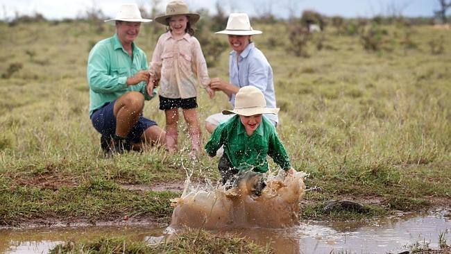 "Farmer Peter Anderson, wife Julia and kids Eliza 5 and Lewis 4 from ""Glenlea"", north east of Clermont, are jumping for joy after receiving over 50mm of rain courtesy of Tropical Cyclone Dylan. Pic Adam Head"