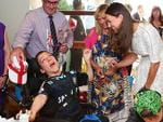 The Duchess of Cambridge speaks with patients and their families at Bear Cottage