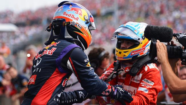 Alonso congratulates Ricciardo after the race.