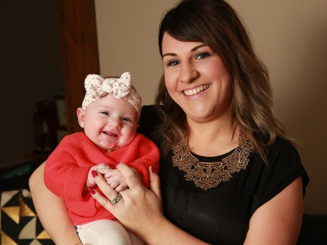 Lara Scott with her five month old baby Lylah, who suffers from epidermolysis bullosa, at their home in Glenmore Park, Sydney in July last year. Picture: Damian Shaw / AAP