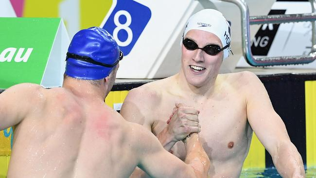 Mack Horton is congratulated by Kyle Chalmers after winning the 200m freestyle. Picture: Getty Images