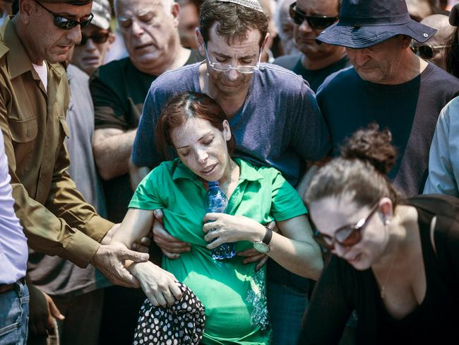 All too much to bare ... family members of Israeli Major Tsafrir Bar-Or mourn and cry during his funeral in Holon, Israel.
